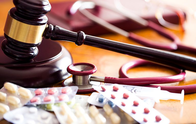 stethoscope and gavel - Defining medical malpractice - suing a doctor - medical negligence - medical errors - Winnipeg Lawyers - Pollock & Company Lawyers